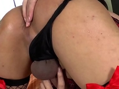 Gorgeous ladyboy fingers her ass