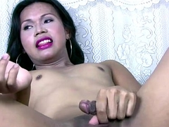 Asian tranny fondles her balls cameltoe and jerks tiny bushwa